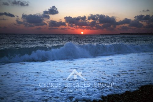 Sunset over the coast of Coral Bay, Paphos region, Cyprus