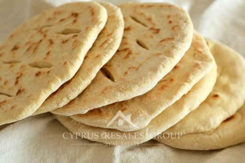 Cypriot Pita bread has a soft fluffy texture.