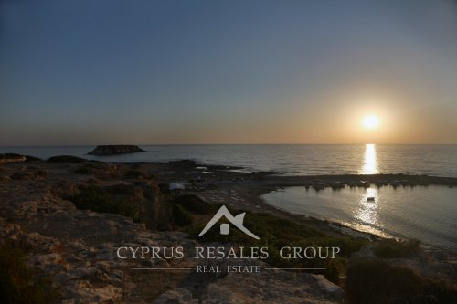 Sunset over Yeronissos island off the coast of St George in Peyia, Cyprus