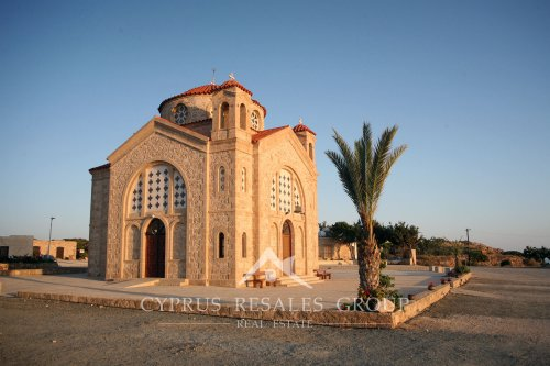 Church of St George on Mediterranean coast in Peyia during a sunset, Cyprus